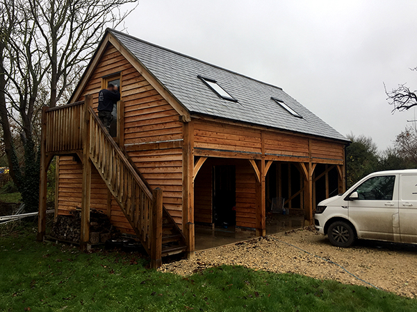 Oak framed 3 bay storey & half garage, front & side elevation, by Shires Oak Buildings