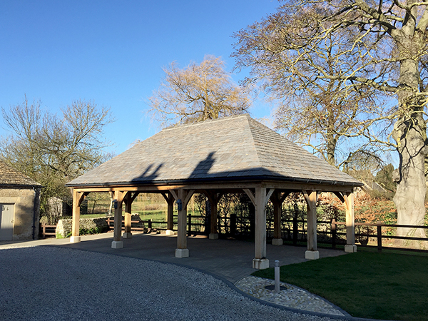 Oak framed 3 bay open carport with hipped roof by Shires Oak Buildings