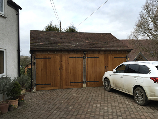 Oak framed 2 bay garage, front elevation, by Shires Oak Buildings