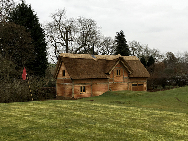 Oak framed mill building with dormers to front and rear by Shires Oak Buildings