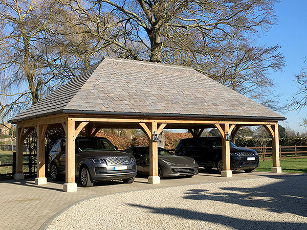 Oak framed 3 bay open carport, hipped roof, by Shires Oak Buildings