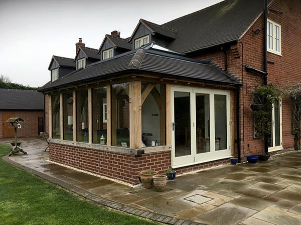 Oak framed orangery extension by Shires Oak Buildings