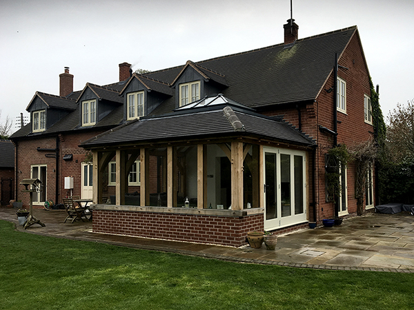 Oak framed orangery extension by Shires Oak Buildings