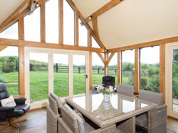 Oak framed garden room, interior view, by Shires Oak Buildings