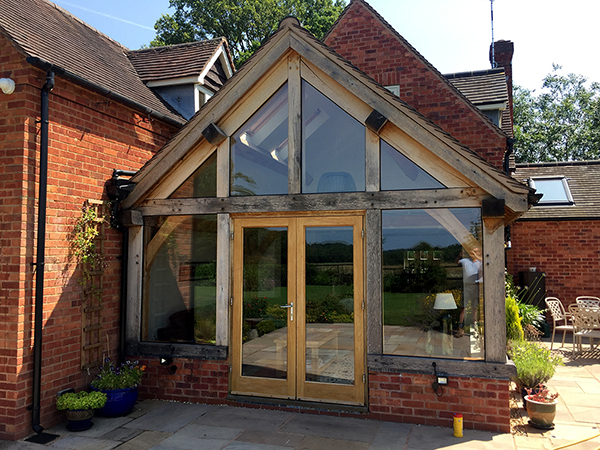 Oak framed garden room with French Doors by Shires Oak Buildings