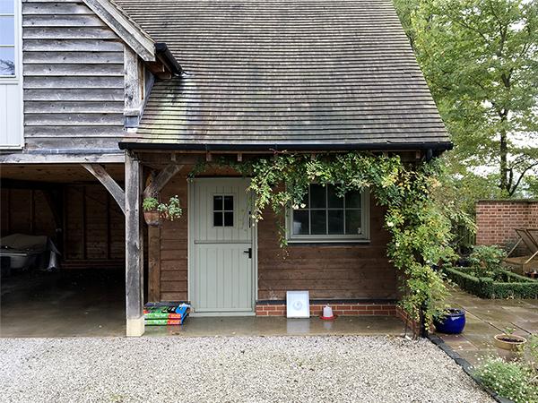 Oak framed 3 bay garage & studio by Shires Oak Buildings, right hand bay detail
