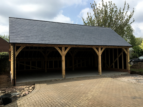 Oak framed 3 bay open fronted garage by Shires Oak Buildings