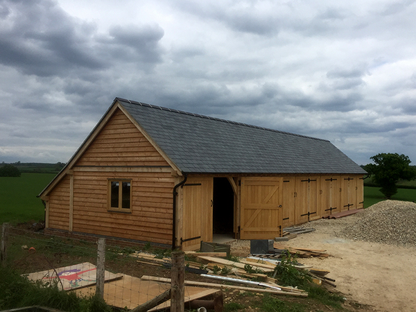 Oak framed 6 bay garage with catslide by Shires Oak Buildings