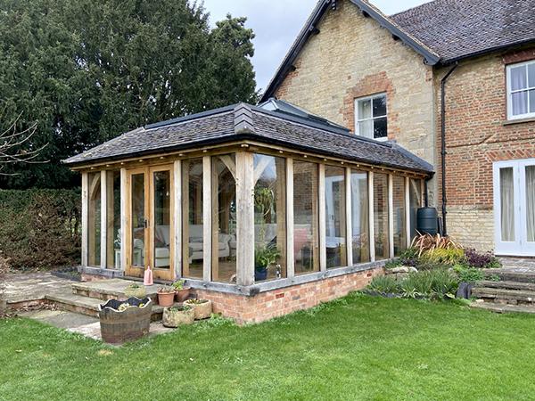 Oak framed orangery with mansard roof by Shires Oak Buildings