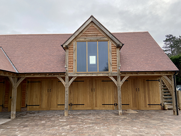 Oak framed garage complex with room over by Shires Oak Buildings