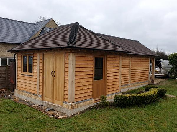 Oak framed garage & workshop by Shire Oak Buildings
