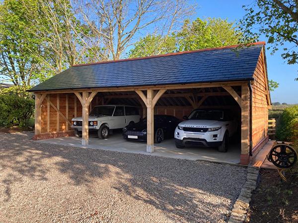 Oak framed 3 bay open fronted garage by Shires Oak Buildings