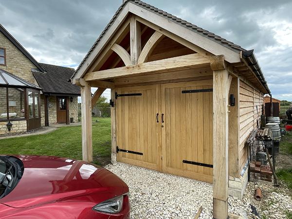 Oak framed garage & workshop by Shires Oak Buildings