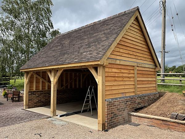 Oak framed 2 bay garage with equal eaves by Shires Oak Buildings