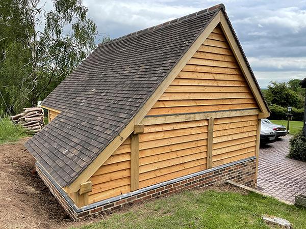Oak framed 2 bay garage with equal eaves by Shires Oak Building