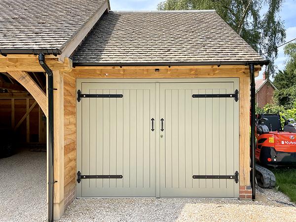 Oak framed 3 bay garage with equal eaves by Shires Oak Buildings